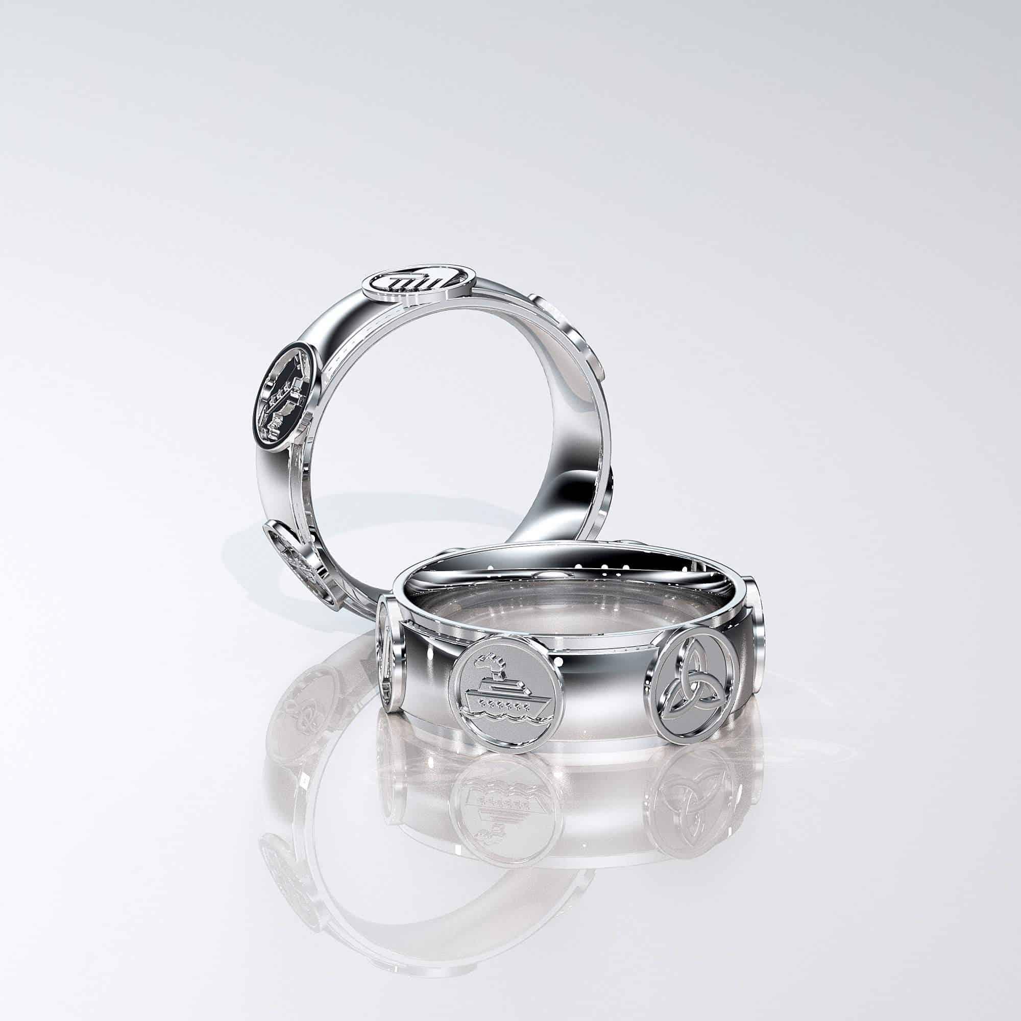 14Karat white Gold ring with 5 symbols on it