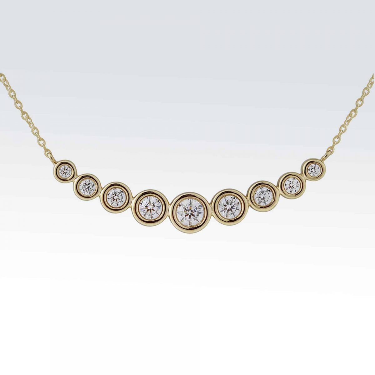 14 karat yellow gold necklace with 7 bezel set diamonds
